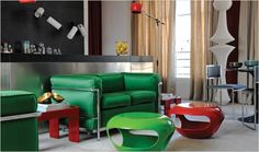 Cassina's LC2 2-Seat Sofa (Charlotte Perriand, Le Corbusier, and Pierre Jeanneret, 1928) looks current and fresh in a bright green fabric.