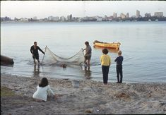215591PD: Prawning in the Swan River with Perth skyline in background, 1968-1970.  http://encore.slwa.wa.gov.au/iii/encore/record/C__Rb2466384__Sprawning%20in%20the%20swan__Orightresult__U__X6?lang=eng&suite=def