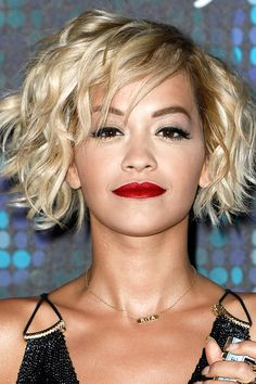 Rita Ora has tried bangs and also the swept-back look.