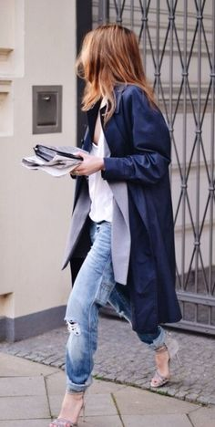 A flowy trench, ripped boyfriend jeans, and a neutral heel make the best laid back work look.