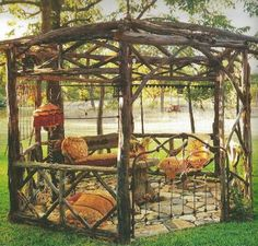 wood gazebo Magnolia Pearl Ranch with iron bed headboard gate Architectural Landscape Design