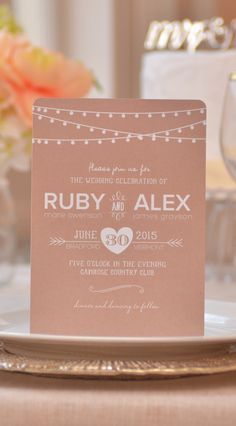 A modern wedding invitation with hanging light details | Brides.com