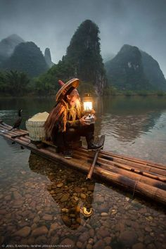 A cormorant fisherman with his lantern. I love this picture so much!