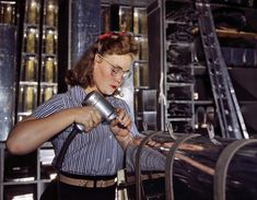 October 1942. Inglewood, California. North American Aviation drill operator in the control surface department assembling horizontal stabilizer section of an airplane.