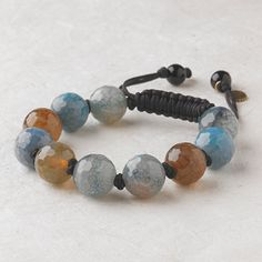 $40.00 Layla #Bracelet Green hues from the #necklace's #agates and smoky #quartz complement the pops of blue from the bracelet's faceted #stones. Bracelet is adjustable. Http://donnaaquilino.jewelry.willowhouse.com