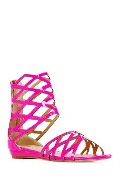 MONTRELLE Nothing says springtime like a sexy, strappy sandal. Can't quite muster a heel? Here's your new go-to that's just as sleek. Multi-strapped ankle shaft with back zipper. Choose black, fuschia or python.