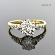 Handmade Edwardian Diamond Engagement Ring. This .91 carat old European cut diamond engagement ring was created by hand with a platinum buttercup setting circa 1905 accented by six single cut diamonds.
