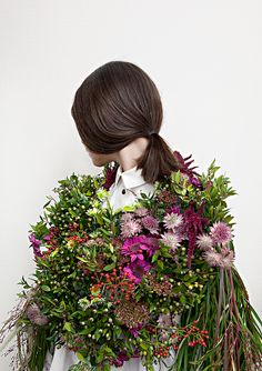 Bouquet of beautiful flowers overshadowing the  blah fashion Alice Knackfuss Flowism