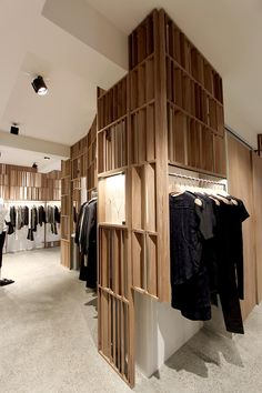 House refection into a store for the fashion designer Isabel Marant. materials: façade: concrete floor: grey / black poured concrete walls: plaster, grey polished concrete ceiling: shuttered concrete, solid sapele wood hanging racks: curved steel profiling black powder coat finish fitting rooms: grey polished concrete, solid sapele wood cladding shoes and accessories display: grey polished …