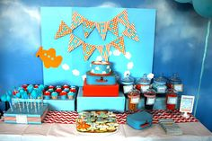 Great airplane birthday dessert table and backdrop! #airplane #birthday #desserttable