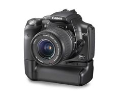 My first proper digital camera was a black EOS 300d like this, it came in a kit with the vertical grip and cheap lens.