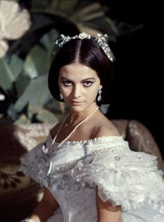 Il gattopardo - Claudia Cardinale as Angelica Sedara wearing a white off-shoulder corseted ballgown. The dress, designed by Piero Tosi and made by Umberto Tirelli at Safas costume shop in Rome. This corset was terrible to wear: it chinched the...
