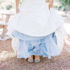 I love the under color of her dress! Such a clever idea for a pop of color while still holding to the white dress!