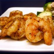 "Nothing says Louisiana like Cajun spices, and a recipe for Lousiana Cajun shrimp will wake up anyone's taste buds. Cajun culture derives from French migrants from North America (the word Cajun is a derivation of ""Acadian"") and the Caribbean. Food is absolutely central to Cajun culture, and Cajun spices are generally hot, including paprika and chili..."