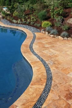 Travertine patio we did in VA with a border of japanese river rocks.