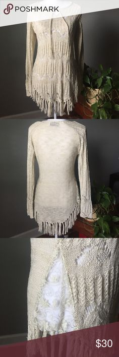 """Crochet Top Really cute cream colored crochet long sleeve top. Has draw strings at top to toe. Has slit on sides with a sheer material sewed into slits. Fringe on bottom. Never worn so no stains or tears or snags. No fringe is missing . 17"""" bust. 29"""" in length. There is some stretch to top. There is not a size tag in top but I would say it's a medium Tops Blouses"""