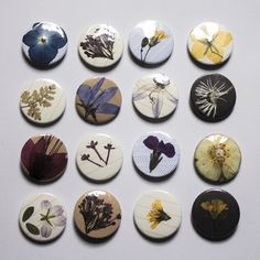 This made me think of a cool idea where you take these button pin things and put pressed flowers into them.. I know there's a way to customize(: