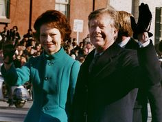 President Jimmy Carter and his wife, Rosalynn, wave to the crowd as they walk down Pennsylvania Avenue after his inauguration ceremony Jan. 20, 1977, in Washington.