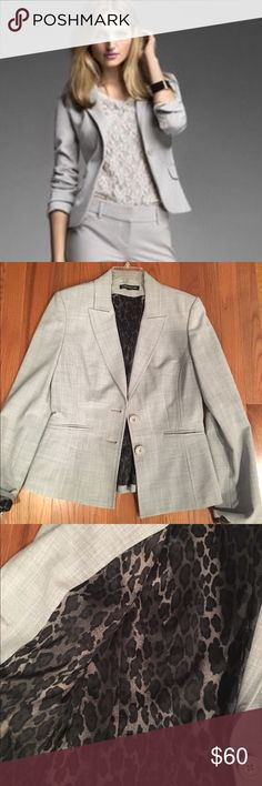 🆕 Express suit jacket Light grey suit jacket with 2 buttons and leopard lining. 16 inches armpit to armpit. Excellent used condition. 2 pockets in the front. Matches the pants also in my closet. Express Jackets & Coats Blazers