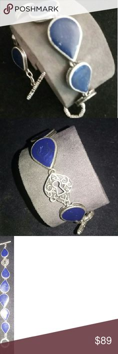 Vintage Blue lapis lazuli silver bracelet handmade Women's bracelet with hand cut lapis Stone, sterling silver bezel colors and each link is constructed of a teardrop shaped sterling silver bezel collar. The collars are filled with hand-cut lapis lazuli stones, and are connected by the fancy sterling silver rings that have been soldered shut for security. The spring ring clasp is sterling silver, each stone measures between 20 to 25 mm, measures 7 1/2 inches long. This handmade bracelet is a…