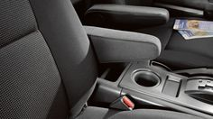 Genuine Toyota Passenger Armrest - Black: Provides comfortable arm support for passenger. Made from durable material with a soft automotive-grade fabric cushion for maximum passenger comfort. Pivots upward for added convenience. Fj Cruiser Parts, 2014 Toyota Fj Cruiser, Home Interior Accessories, Fords 150, Toyota Dealers, First Time Driver, Vw Sharan, Gear Shop, Volkswagen Polo