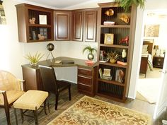 This corner desk and bookshelf unit in the Pecan Valley III 2040 Sq Ft Double-wide Manufactured Home in Mesquite,Texas, is a great use of space in this office! Modular Home Designs, Modular Homes, Home Renovation, Home Remodeling, Palm Harbor Homes, Display Homes, Metal Homes, Built Ins, Interior And Exterior