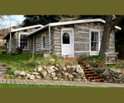 """""""Come enjoy a piece of Helena's mining history, the original Pioneer Cabin. This historic building is the oldest documented dwellingstill standing in Helena, dated back to 1864. Visitors are welcome to enter the cabin through the side (south-facing) door. Weather permitting, the cabin will be open for self-guided tours through Wednesday, September 30."""