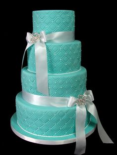 Traditional Tiffany Blue Wedding Cake with a modern twist: brooches are actually hair clips from an accessories store