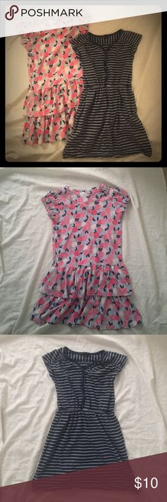 2 girl dresses 2 girl dresses both size 10. Floral dress has button fastening in the back along the neck and is from Gymboree. Navy blue with grey strips, has elastic around waist area and shoulders, from Gap Kids. Both in good condition, comes from pet and smoke free home. Dresses Casual