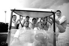 The groom and his men going for a golf cart spin at a destination wedding in Cancun at the Moon Palace Resort.  Mexico wedding photographers Del Sol Photography