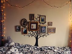 such a brilliant, simple idea for organizing picture frames and adding flair to a room.
