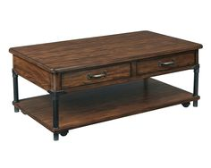 Saluda Cocktail Table   The Saluda Cocktail Table has a casual look, with a slightlydistressed warm-oak finish on rubberwood solids and oak veneers, gunmetal-finished metal accents, and pewter hardware. It has two drawers, a shelf, and convenient casters.