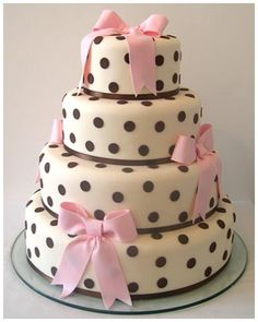 beautiful polka dot cake with pink bows