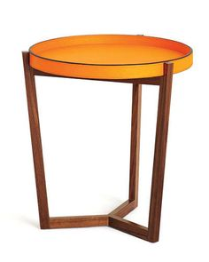 """For Bengur, this leather tray in chic orange conjures up 1930s French style. She's intrigued that it comes in a rainbow of other hues: """"I love a shock of color in a space."""" The legs of the 20.5""""-tall walnut base converge at precise mitred corners. """"It's nicely done and sculptural,"""" she notes. """"It would be perfect beside a chair."""" $732; davidlinley.com."""