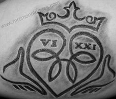 Not only a claddagh, and endless knot tattoo, it says 6-21. Holy