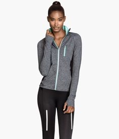 Fitted running jacket in fast-drying, breathable functional fabric with a stand-up collar. Zip at front, ventilating mesh sections at sides and on sleeves, and reflective details. Side pockets with concealed zip and chest pocket with zip. and opening on one sleeve for a sports watch. Ribbed cuffs with thumbholes. Size of chest pocket 4 x 5 in.