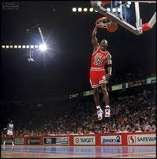 Michael Jordan finishes off a fast break with an emphatic slam dunk against  the Denver Nuggets in November Jordan scored 38 points with 12 assists and  seven ... 25e562d377cb