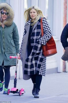 School run: Sienna Miller looked effortlessly chic as she stepped out with a pal in NYC on...