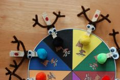 Free download for Christmas clothespin wheels that work on matching colors and letters, counting, and fine motor skills!