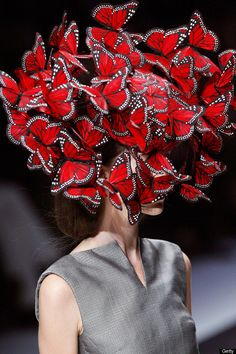 "Philip Treacy for Alexander McQueen. Hat, La Dame Bleue, S/S Turkey feathers painted and shaped like butterflies. Featured in Alexander McQueen: Savage Beauty in Gallery Three, ""Cabinet of Curiosities."" Photo by Getty Images. Alexander Mcqueen, Mode Bizarre, Philip Treacy Hats, Isabella Blow, Party Fiesta, Crazy Hats, Wedding Hats, Love Hat, Minimalist Lifestyle"