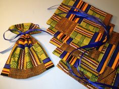 Afrocentric fabric favours: Easy make at home: A cute idea that gets cuter when you find fabric on sale. Cut bags and tie with color coordinated string. Fill with candy and you have a great party-favor. African Wedding Theme, African Theme, Wedding Gift Bags, Wedding Party Favors, Wedding Invitations, Royalty Baby Shower, Afro Chic, African Inspired Clothing, Traditional Wedding Decor