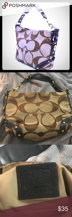 """Coach!! Authentic Coach khaki signature Carly tote handbag. Features gold-tone hardware, black leather trim and accents, a single black leather shoulder strap (7"""" drop), and a top zipper closure. Interior of handbag is lined in khaki textile fabric with a side zipper pocket, a side open pocket, and a cell phone/accessory pocket. Includes Coach dust bag. Made in China. Authenticity/Serial #: E0726-10619.PRE LOVED whit Sings of wear no new Coach Bags Shoulder Bags"""