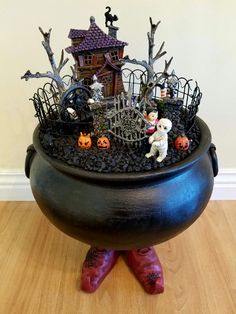 """Miniature Garden - A TRICK FOR NO TREATS! On Halloween, three Trick-or-Treaters play a trick on a silly witch for not having treats for them! The witch has two black cats, one is trying to scare the three visitors, but it's not working, and the other cat is on the rooftop; the witch uses skulls as pillows for her black bench; the witch has three scary Jack-o-Lanterns just in front of her """"Keep Out"""" gate! The Trick-or-Treaters have adorable costumes and can be seen exiting the witch house…"""