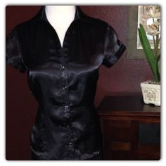 Black satin like top with buttons closure No rips, stains, damages. This is the perfect top to wear under a blazer for work! Rampage Tops