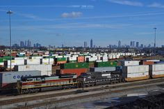 The Midtown and Downtown skylines of Atlanta can be seen in this view overlooking Norfolk Southern's Inman Yard in Atlanta, Ga.  Intermodal train 282, being led by the Lackawanna heritage unit, will soon depart the yard for another leg of its journey from Jacksonville, Fl., to Chicago.