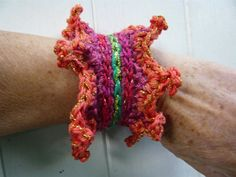 hand made crochet pinkredgreenorange cuff by Lepapadesmatous, $25.00