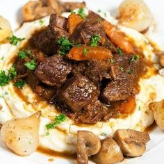 Classic French Beef Bourguignon -To serve, coat the beef, carrots, mushrooms and pearl onions with the sauce. Serve family style with lots of crusty bread.