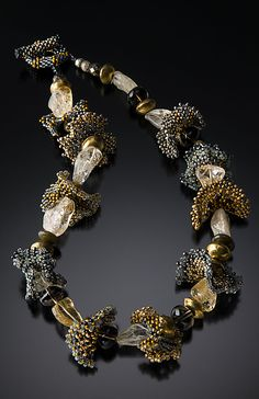 Artful off loom beading and natural stones combine to make an exquisite necklace.