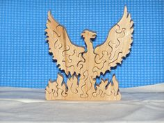 Hey, I found this really awesome Etsy listing at… Scroll Saw Patterns, Wood Patterns, Intarsia Woodworking, Woodworking Crafts, Intarsia Patterns, Dragon Pattern, Wooden Puzzles, Diy Toys, Craft Work
