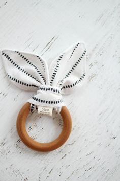 |Bebe Stripe| A teether is an essential for babies and small children. We created a solution for sore gums with a maple wood ring, brushed with organic beeswax and olive oil. Each teething ring comes with a fabric tie- offering style, a printed color, and development of fine motor skills for baby. All teethers must be used with parental supervision. If the wooden ring starts showing any signs of wear, discard immediately. Do not throw ring as this could increase the risk of breaking. Know…